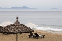 Cua dai beach with sunshade in Hoi an, Vietnam. royalty free stock photography