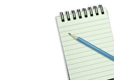 Cuaderno aislado de la carpeta con el papel y el azul alineados Foto de archivo