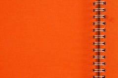 Cuaderno anaranjado Fotografía de archivo