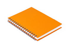 Cuaderno anaranjado Imágenes de archivo libres de regalías