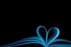Cuaderno azul y corazón de la dimensión de una variable Imagen de archivo