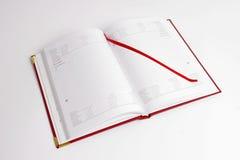 Cuaderno con el calendario Fotografía de archivo
