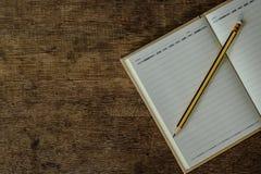 Cuaderno con el lápiz Foto de archivo libre de regalías
