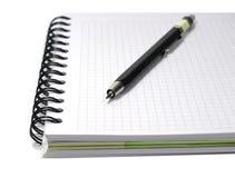 Cuaderno con el lápiz mecanical aislado en blanco Foto de archivo