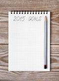 Cuaderno con el lápiz y metas del año 2015 Imagen de archivo libre de regalías