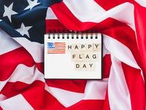 Cuaderno con enhorabuena el día de la bandera imagen de archivo libre de regalías