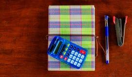 Cuaderno con la calculadora Fotografía de archivo libre de regalías