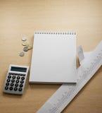Cuaderno con la calculadora Fotos de archivo libres de regalías