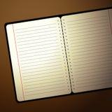 Cuaderno con la luz de la lámpara Imágenes de archivo libres de regalías