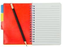 Cuaderno con la señal y el lápiz rojos Foto de archivo