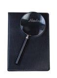 Cuaderno con magnificar Imágenes de archivo libres de regalías