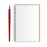 Cuaderno con una pluma Fotografía de archivo libre de regalías