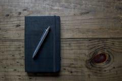 Cuaderno de cuero negro Imagen de archivo libre de regalías