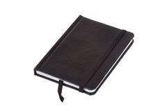 Cuaderno de cuero negro en blanco de la cubierta, aislado en blanco Fotografía de archivo libre de regalías