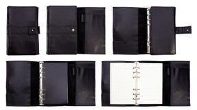 Cuaderno de cuero negro en el fondo blanco Fotos de archivo libres de regalías