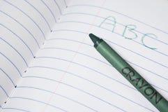 Cuaderno de la escuela del niño Imagenes de archivo
