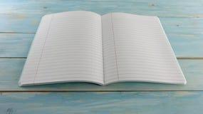 Cuaderno de la escuela en el fondo de madera azul del tablero - bandera de la educación foto de archivo libre de regalías