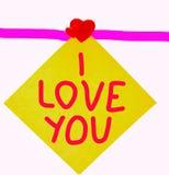 Cuaderno de los corazones del ` s de la tarjeta del día de San Valentín con una inscripción imágenes de archivo libres de regalías