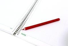Cuaderno de notas del negocio con la pluma Fotografía de archivo libre de regalías