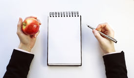 Cuaderno de notas en un fondo blanco Foto de archivo libre de regalías
