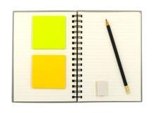 Cuaderno e inmóvil Fotos de archivo libres de regalías
