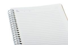 Cuaderno en blanco aislado en blanco Foto de archivo libre de regalías