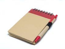 Cuaderno en blanco aislado en el libro blanco/del espacio en blanco con el aislante de la cubierta Fotos de archivo libres de regalías