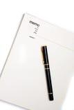 Cuaderno en blanco de la pista de nota Fotos de archivo libres de regalías