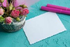 Cuaderno en blanco en fondo de la aguamarina Fotografía de archivo