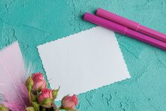 Cuaderno en blanco en fondo de la aguamarina Foto de archivo libre de regalías
