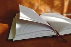 Cuaderno en el banco Imágenes de archivo libres de regalías