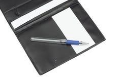 Cuaderno en el fondo blanco Fotos de archivo