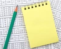 Cuaderno en el fondo de dígitos Imagen de archivo libre de regalías