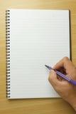 Cuaderno en la tabla Foto de archivo