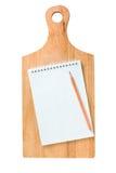Cuaderno en la tarjeta de la cocina Fotografía de archivo libre de regalías
