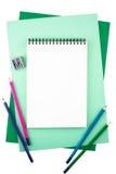 Cuaderno en las hojas del papel texturizado coloreado que imita un marco Fotografía de archivo libre de regalías