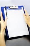 Cuaderno en manos Fotografía de archivo