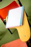 Cuaderno en un escritorio Imagen de archivo