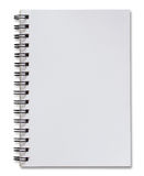 Cuaderno espiral blanco en blanco aislado en blanco Fotos de archivo libres de regalías