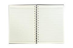 Cuaderno espiral con la línea papel aislado en blanco Imagenes de archivo