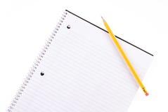 Cuaderno espiral y lápiz Imagenes de archivo