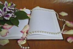 Cuaderno a la enhorabuena Fotografía de archivo libre de regalías