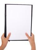 Cuaderno la mano del adolescente Foto de archivo