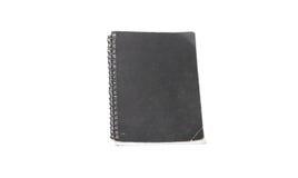 Cuaderno negro viejo en el fondo blanco Imágenes de archivo libres de regalías
