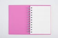 Cuaderno púrpura de la cara para el fondo y el texto Foto de archivo libre de regalías