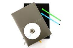 Cuaderno/pluma/CD fotografía de archivo