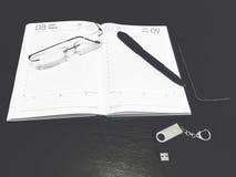 Cuaderno, pluma, vidrios Imagen de archivo