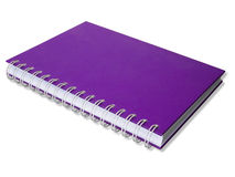 Cuaderno púrpura de cubierta Fotos de archivo libres de regalías