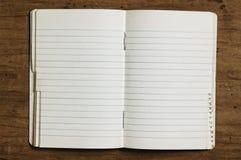 Cuaderno puesto en un índice imagen de archivo