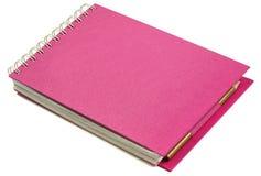Cuaderno rosado Imágenes de archivo libres de regalías